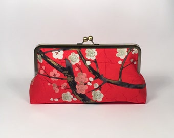 Cheery blossoms in red clutch purse