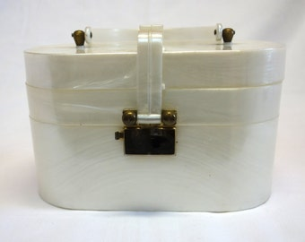 A faux mother of pearl lucite handbag, circa 1950s.