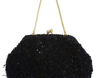 A vintage black beaded and sequinned evening bag