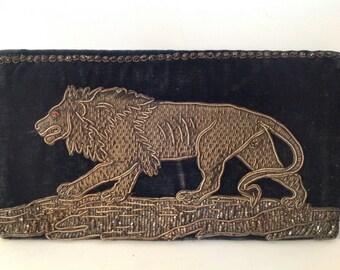 A vintage black velvet evening clutch bag