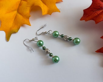 green and silver color dangle earrings