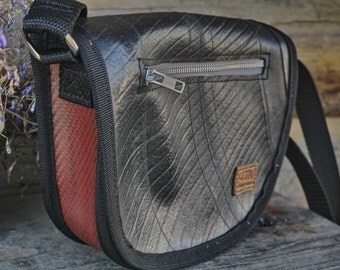 Upcycled handbag made from fire hose and truck tube.