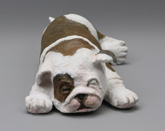 A little Bulldog asleep papier mache sculpture
