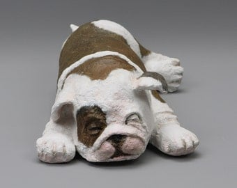 Sculpture papier mache of a sleeping Bulldog puppy