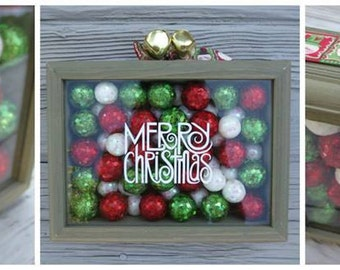 Green Merry Christmas Shadow Box with Red, Green & White Opalescent Glitter Balls, Santa and Snowman Ribbon, and Jingle Bells