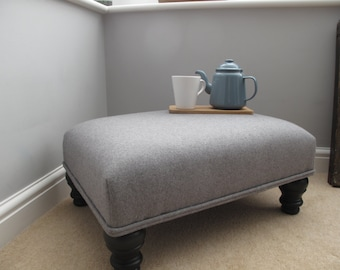 Handcrafted footstool with luxurious pure grey wool upholstery