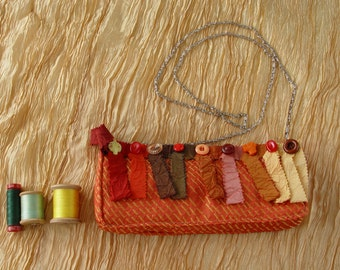 ORANGE CLUTCH BAG with buttons
