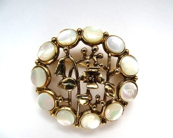 Mother of Pearl circle encrusted vine brooch.  Vintage Spring flowers.