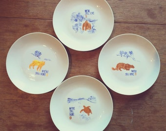 We're Still Here: set of 4 hand painted plates