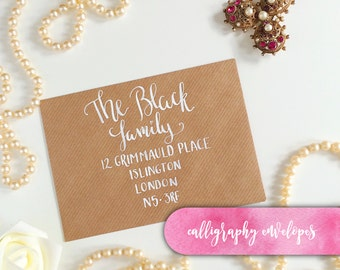 Calligraphy Envelopes, hand lettered envelopes for wedding invitations, modern calligraphy, A5 or A6. White ink on brown kraft envelope.