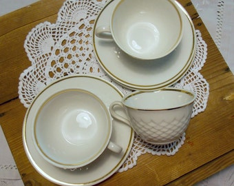 Set of 3 white porcelain cups, edged gold