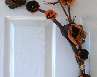 handmade wall hanging from driftwood,handmade flowers and copoer embellishments