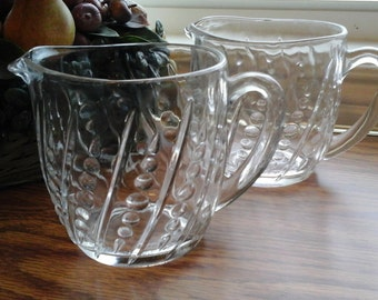 Two Two Cup Pitchers, Small clear glass pitcher, raised dot and dash pattern, pressed glass