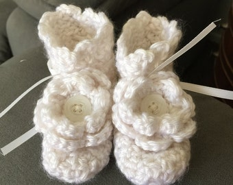White crocheted baby booties with flower, size 3-6 months