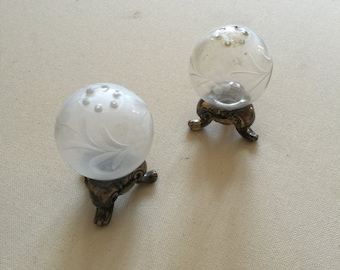 Two adorable antique salt and pepper shakers