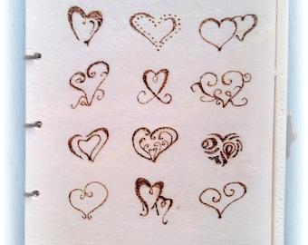 Wooden lockable nine hearts book