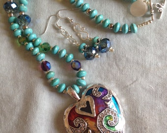 Turquoise look bead with heart pendant .