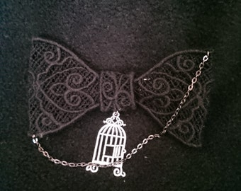 Black lace hair bow with silver chain and birdcage charm
