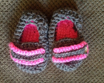 Pink and gray baby booties
