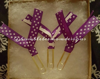 Purple and white polka dot paperclips