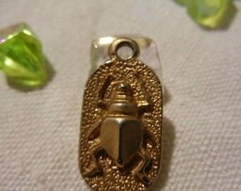 Pendant style Egyptian biface gold metal