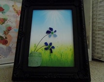 Sea Glass Picture, Artist Andrea Hickling, Inspiration poem: Blue Flowers. Especially the blue. Set within an open fronted frame