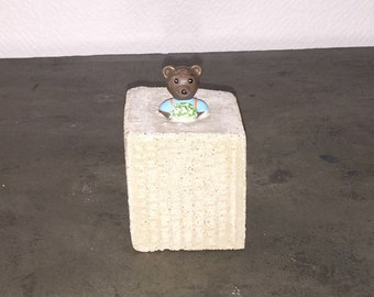 Teddy bear and concrete