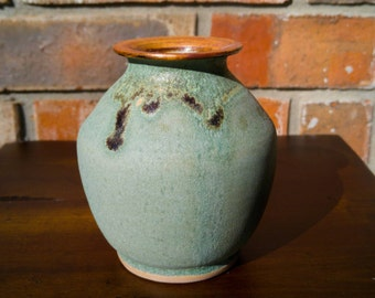 Small green vase with crystalline glaze. Wheel thrown.