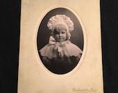 Antique Mounted Photo of a Precious Little Girl Wearing a Bonnet, 1910 Vintage Photo by Bushwick Ave Studio