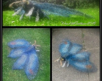 Handmade giant blue moth wire sculpture.