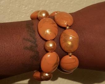 orange and gold bangles