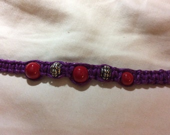 Purple hemp bracelet with red and silver beads