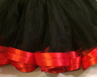 Black tutu trimmed with red satin ribbon