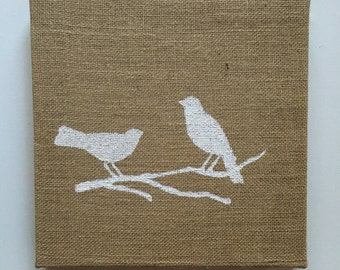 White birds on burlap canvas