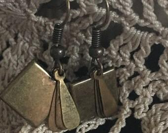 mixed metal square earrings.