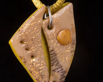 Unusual Lime, cream, gold coloured polymer clay pendant, with gold leaf,  on gold coloured satin necklace