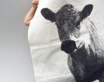 Holy Cow linen tea towel, charcoal ink on off-white linen. Hand screen printed original cow design.