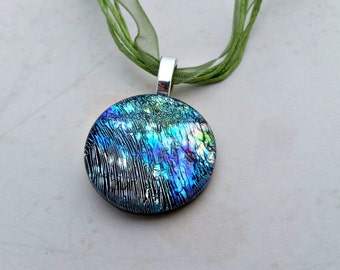 Round Dichroic Fused Glass Pendant with Blues, Greens, Purple, and hints of Brown 16133