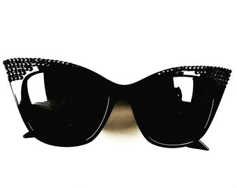 Blacked out cat eye sunglasses