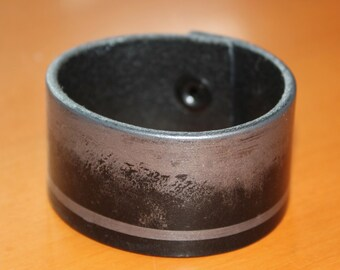upcylced/recycled black leather cuff with pewter painted detail