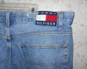 Vintage 1990s Tommy Hilfiger Jeans Large Flag Logo Cotton Denim Name Printed Down Leg Seams Hipster Retro Spellout Mens Size 38 / 32