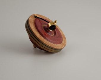 Spinning wooden top by Martin Fischer