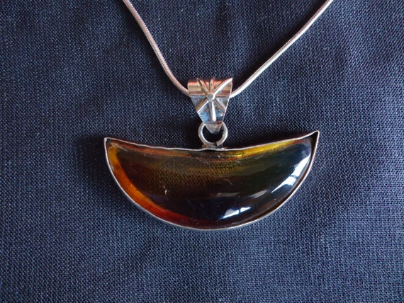Half moon shaped pendant- orange Mexican amber- sterling silver