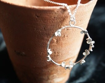 Beautiful tiny flowers clustered on a silver hoop with a fine silver chain - by Zephirine