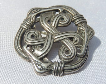Old brooch in Celtic decoration punched money