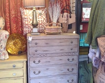 Uniquely Distressed Waterfall Dresser