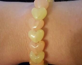 Orange and yellow heart glow in the dark beaded handmade bracelet
