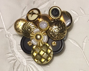 Gold and black button brooch