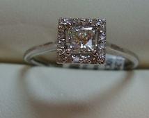 Platinum diamond ring .39 carat SI1-G  princess cut diamond + .10cttw  round Diamond
