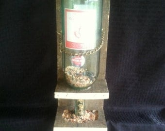 Bottle bird feeder. Reclaimed wood bird feeder with wine bottle dispenser